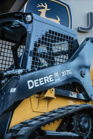Up close of John Deere 317G equipment